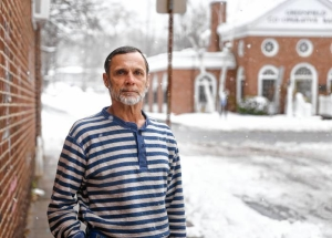 Ralph Provost stands for a portrait outside of The RECOVER Project on Friday in Greenfield, Nov. 16, 2018. Provost spent a winter homeless, sleeping under the stairs of a building under construction. Now Provost lives in a ServiceNet transitional home, but is unsure where he is able to go next with his current income.
