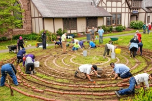 Community members and volunteers work to build a labyrinth on the campus of the Episcopal Church of Saints James and Andrew on Federal and Church streets Thursday in Greenfield.